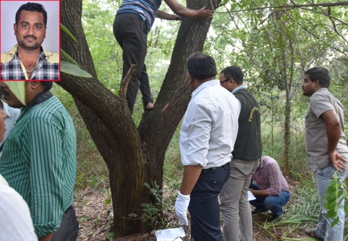 Forensic experts collecting samples from the scene where Ramesh (inset) was found hanging at the Jnanabharathi campus in Bengaluru on Saturday. DH Photo/S K Dinesh
