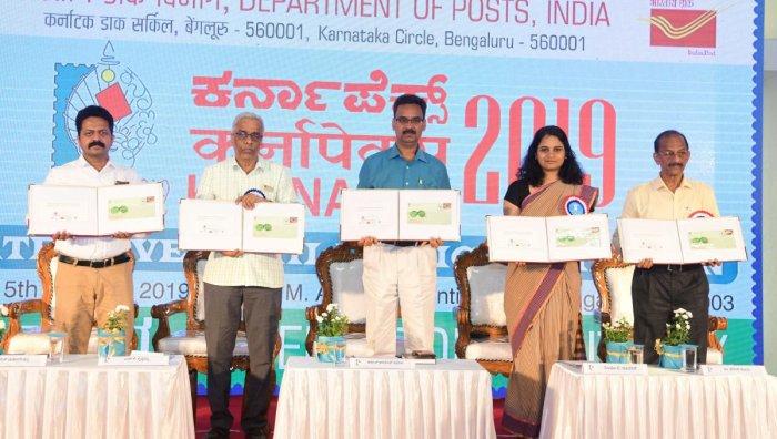 Dakshina Kannada Deputy Commissioner Sindhu BRupesh releases the special cover on 'Mattu Gulla', during 'Karnapex 2019' in Mangaluru on Sunday.