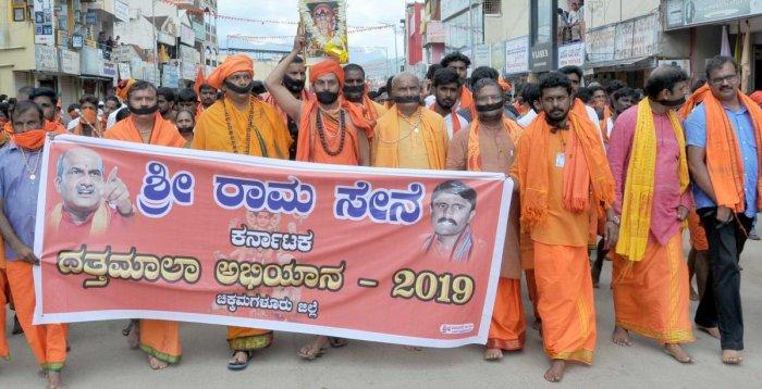 Sri Rama Sene leaders Pramod Muthalik, Gangadhar Kulakarni, Ranjith Shetty and others hold a silent protest in Chikkamagaluru on Sunday.