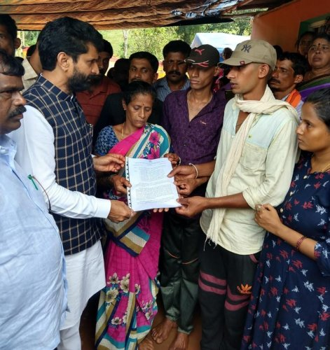 District In-charge Minister C T Ravi hands over the compensation sanction letter to the family of farmer Chandre Gowda, who committed suicide at S K Megal in Kalasa recently.