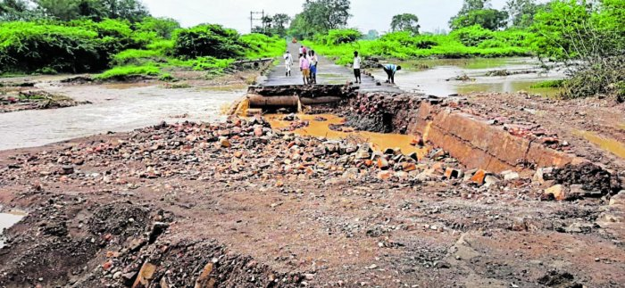 The bridge between Chikkoppa and Karimani near Bailhongal in Belagavi district has been washed away due to rain. DH Photo