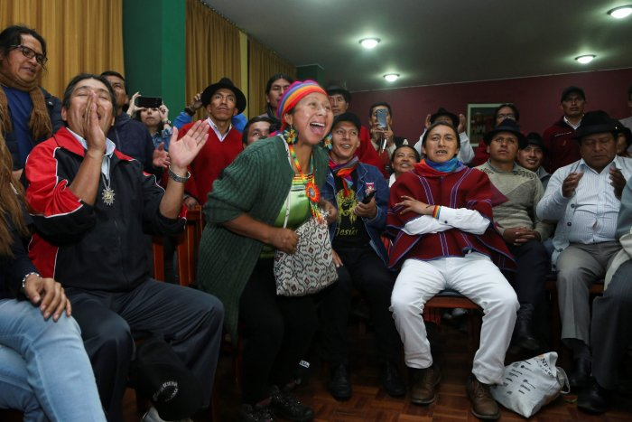 Indigenous people celebrate after a meeting with the Ecuadorean president in Quito. (AFP Photo)