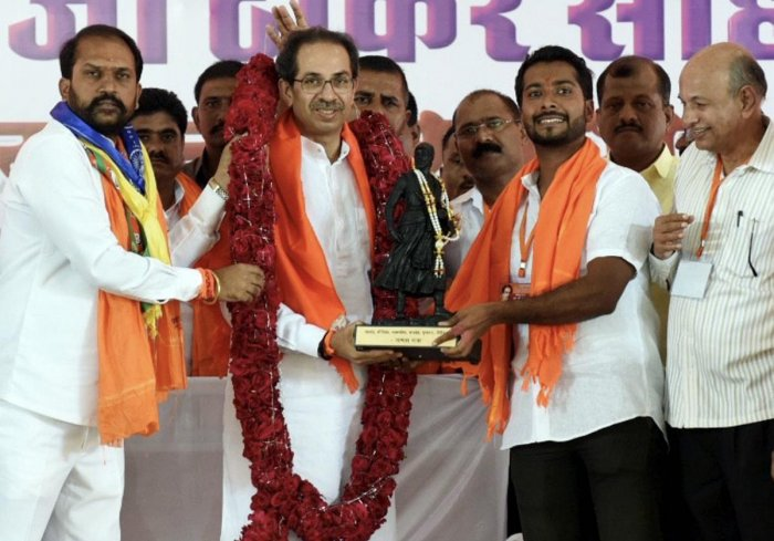 Shiv Sena chief Uddhav Thackeray being presented a memento during an election campaign rally in support of the BJP-Sena candidate Rahul Patil ahead of the Maharashtra Assembly polls, in Parbhani, on Sunday. PTI
