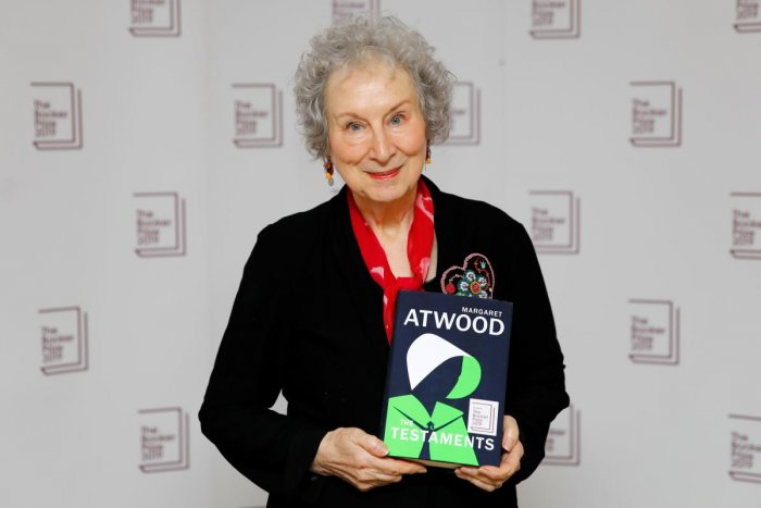 Canadian author Margaret Atwood poses with her book 'The Testaments' during the photo call for the authors shortlisted for the 2019 Booker Prize for Fiction at Southbank Centre in London on October 13, 2019. (AFP)