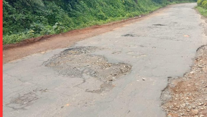 The pothole-ridden road at Thalathamane in Kodagu district.