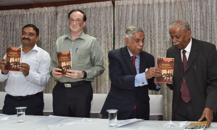 "Former Chief Justice of India M.N. Venkatachaliah release a book "" Challenges of a tropical forester for sustainable development"" by IFS (Rtd), A C Lakshmana (Extreme right), during the book release program at Aranya Bhavan in Bengaluru on Monday, 14 Octo"