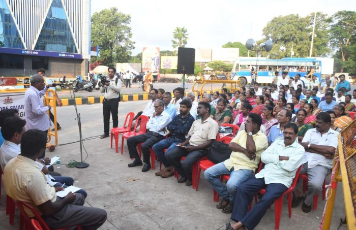 CPI(M) district committee general secretary V Kukyan addresses the people during a public meet, at State Bank Circle in Mangaluru on Monday.