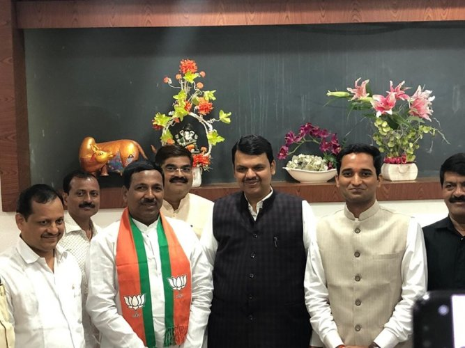 Former NCP MLA Bapusaheb Pathare with chief minister Devendra Fadnavis