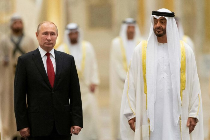 Russian President Vladimir Putin and Abu Dhabi Crown Prince Mohammed bin Zayed al-Nahyan attend the official welcome ceremony in Abu Dhabi, United Arab Emirates, on October 15, 2019. (Photo by Alexander Zemlianichenko / POOL / AFP)