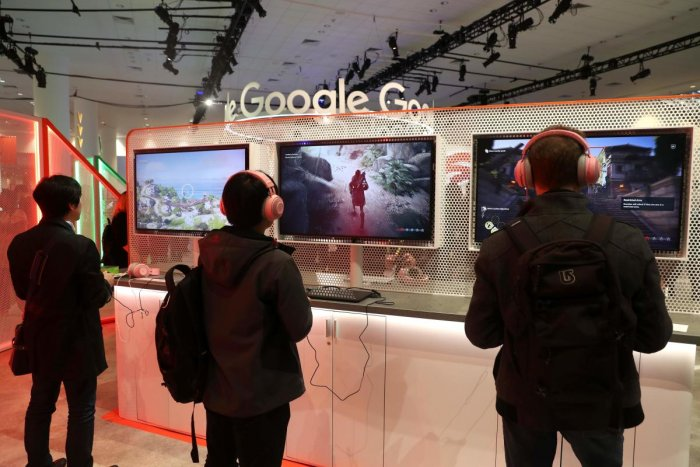 (FILES) In this file photo taken on March 20, 2019 attendees play games on the new Stadia gaming platform at the Google booth at the 2019 GDC Game Developers Conference in San Francisco, California. AFP