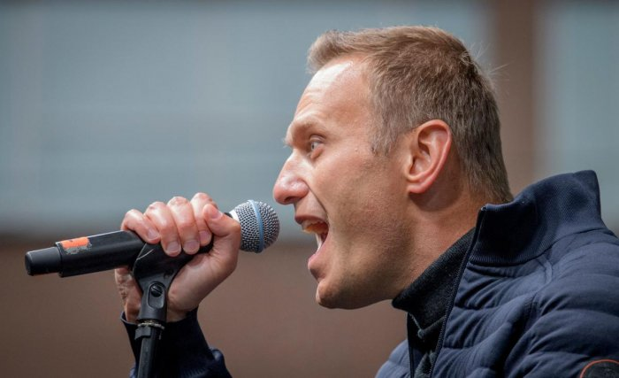Russian opposition leader Alexei Navalny delivers a speech during a demonstration in Moscow. (Photo by AFP)