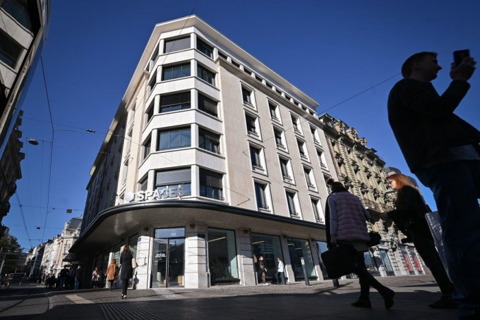 A photograph taken on October 11, 2019, shows pedestrians passing by the building hosting Facebook's Libra Networks LLC company downtown Geneva, as Paypal announced they will withdraw from the Libra network. (AFP)