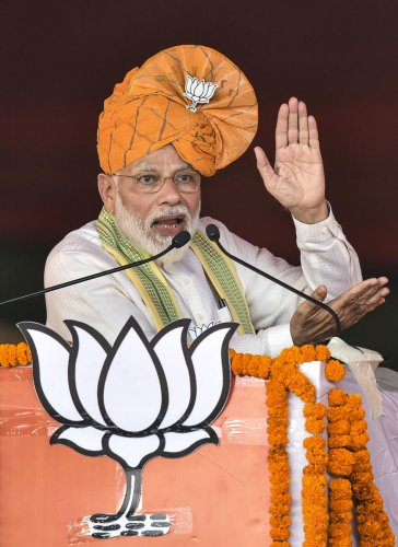 Prime Minister Narendra Modi addresses an election campaign rally for upcoming Haryana Assembly polls, at Ballabgarh in Faridabad district, Monday, Oct. 14, 2019. (PTI Photo)