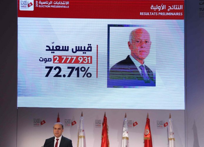 ISIE President Nabil Baffoune gives a press conference to announce the results of Tunisia's Presidential elections on October 14, 2019 in Tunis. (AFP)