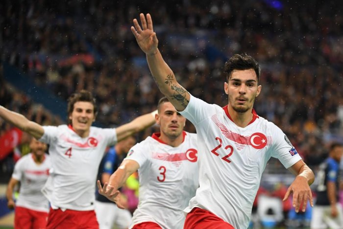Turkey's defender Kaan Ayhan (R) celebrates after scoring the equalizer during the Euro 2020 Group H qualification football match between France and Turkey at the Stade de France in Saint-Denis, outside Paris on October 14, 2019. (AFP)