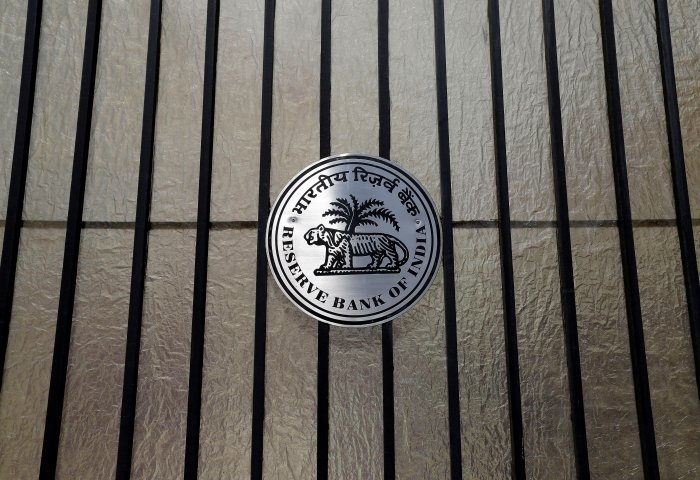 A Reserve Bank of India (RBI) logo is seen at the entrance gate of its headquarters in Mumbai. (Reuters Photo)