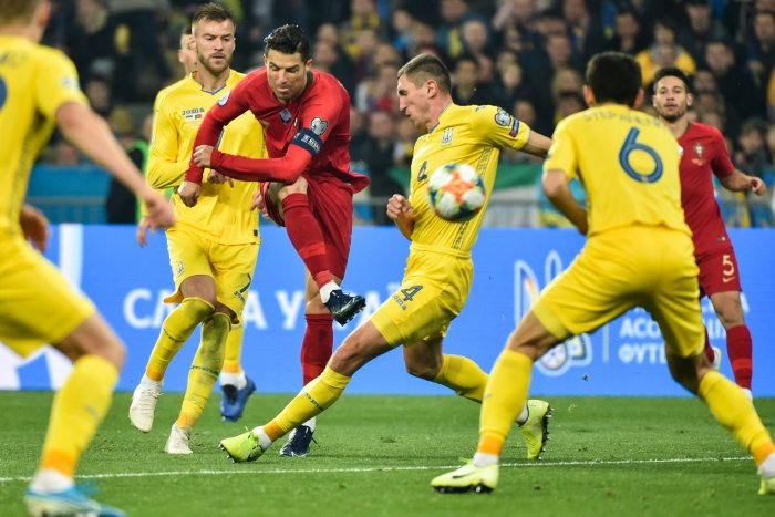 Portugal's forward Cristiano Ronaldo kicks the ball during the Euro 2020 football qualification match between Ukraine and Portugal at the NSK Olimpiyskyi stadium in Kiev. (AFP Photo)