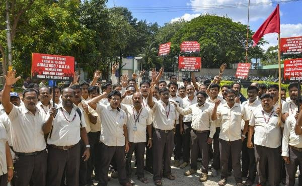Members of All India HAL trade unions raise slogans as they stage a protest during their strike to demand for fair and early settlement of wage revision of employees, in Bengaluru. (PTI photo)
