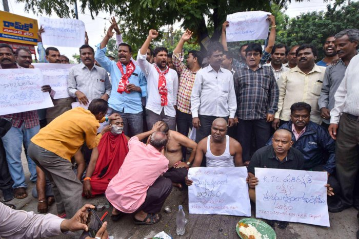 Agitating Telangana State Road Transport Corporation (TSRTC) get their heads tonsured during their ongoing strike, in Hyderabad, Wednesday, Oct. 16, 2019. Their demands include merger of the RTC with the government, pay revision, recruitment to various posts, among others.(PTI Photo)