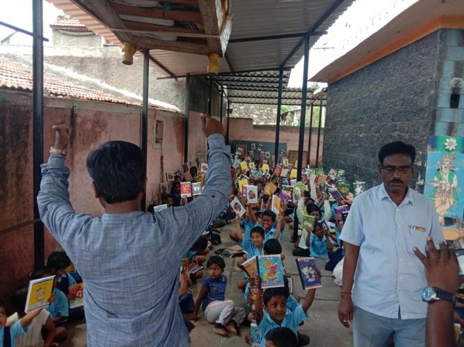 Classes are held at a temple, following damages to the classroms at the government higher primary school in Raibag taluk of Belagavi district. dh photo