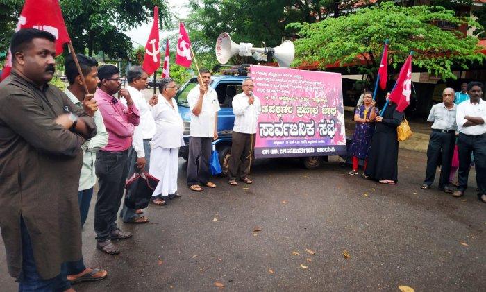 CPM District Secretary Balakrishna Shetty speaks at a protest at Martyrs Memorial in Ajjarakadu in Udupi on Tuesday.