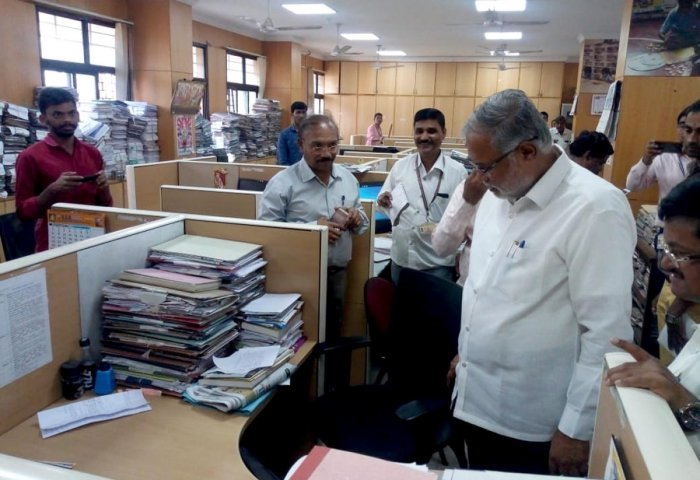 Primary and Secondary Education Minister S Suresh Kumar takes stock of pending files at the department at the education secretariat office in Bengaluru on Wednesday.