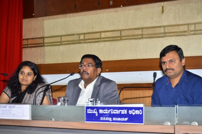 District In-charge Secretary N Manjunath Prasad, flanked by Deputy Commissioner Sindhu B Rupesh (left) and Zilla Panchayat CEO Dr R Selvamani, chairs a review meeting at the Zilla Panchayat hall in Mangaluru on Wednesday.