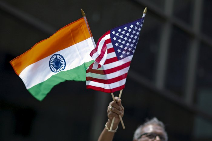 A man holds the flags of India and the US. (Reuters Photo)