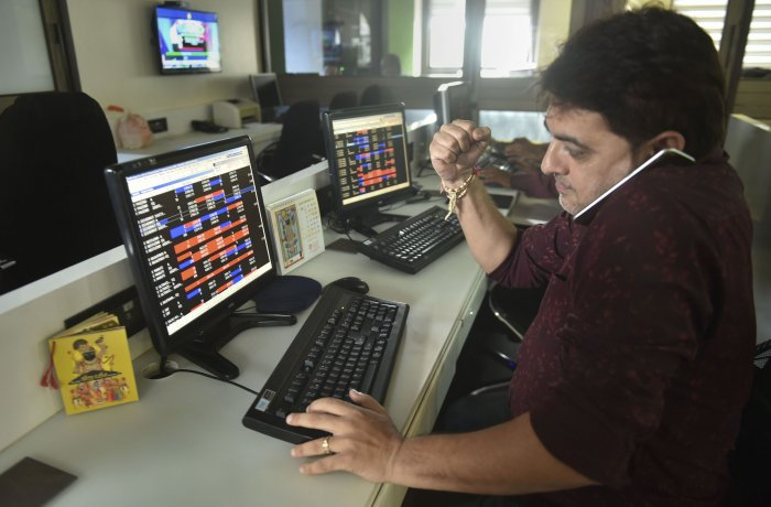 Stock broker react as they watch the stock prices on a computer screen, at BSE building in Mumbai. (PTI Photo)