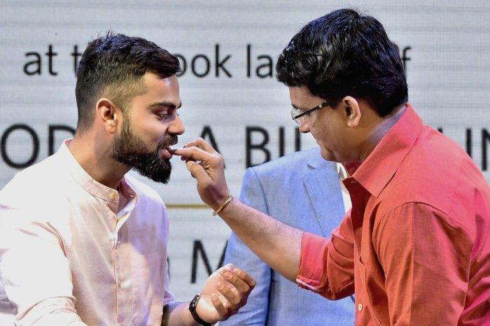Indian cricket captain Virat Kohli (L) with former captain Sourav Ganguly (R) (PTI File Photo)