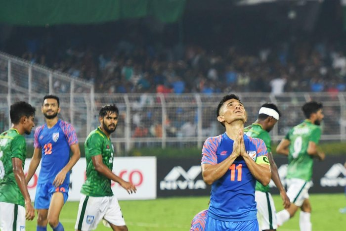 Sunil Chhetri (R) reacts after missing a goal during the World Cup 2022 and 2023 AFC Asian Cup qualifying football match between India and Bangladesh at the Vivekananda Yuba Bharati Krirangan in Kolkata on October 15, 2019. (AFP)