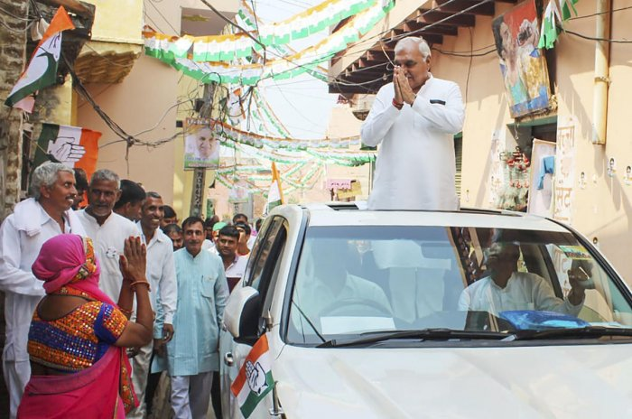Former Chief Minister of Haryana Bhupinder Singh Hooda during his election campaign in Garhi Sampla-Kiloi constituency in Rohtak district on Wednesday. (PTI Photo)