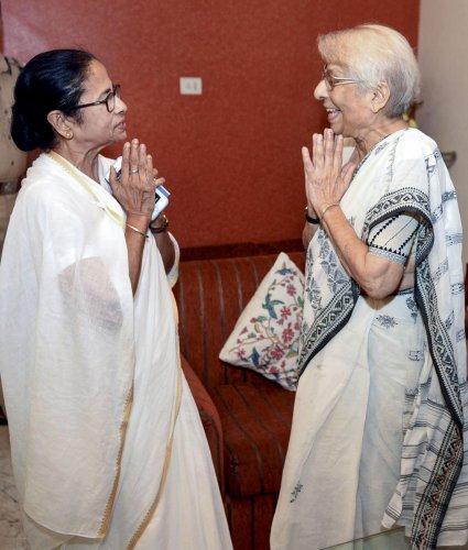 West Bengal Chief Minister Mamata Banerjee exchanges greetings with Nirmala Banerjee, mother of Indian-American Nobel Prize winning economist Abhijit Banerjee, in Kolkata on Wednesday. (PTI Photo)