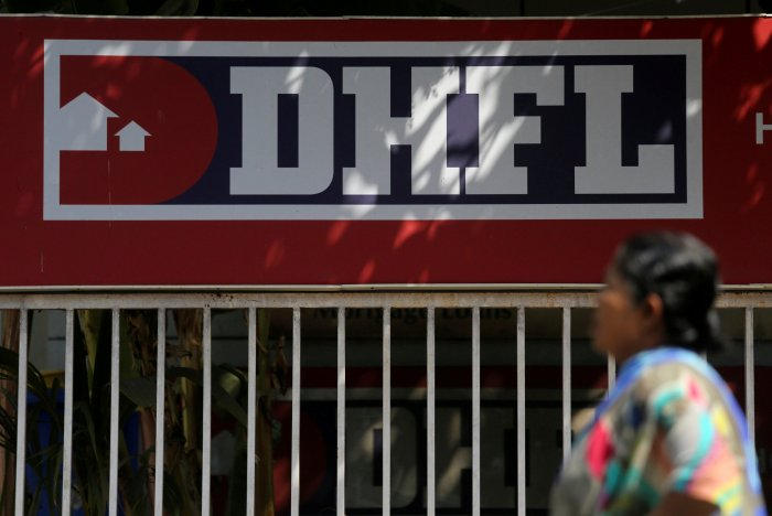 A woman walks past a Dewan Housing Finance Corporation Ltd. (DHFL) sign outside its office on the outskirts of Mumbai, India. (Reuters Photo)