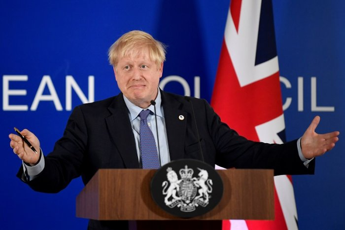 Britain's Prime Minister Boris Johnson attends a news conference at the European Union leaders summit dominated by Brexit, in Brussels, Belgium. (Reuters Photo)