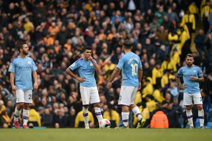 Manchester City players react after conceding their second goal during the English Premier League football match. (AFP Photo)