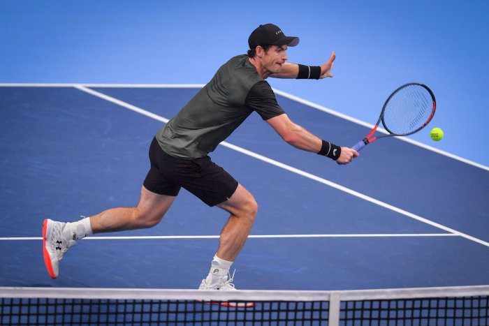 Britain's Andy Murray returns a shot during a tennis match against Uruguay's Pablo Cuevas, in the second round of the men's singles tournament at the European Open ATP Antwerp. (AFP Photo)