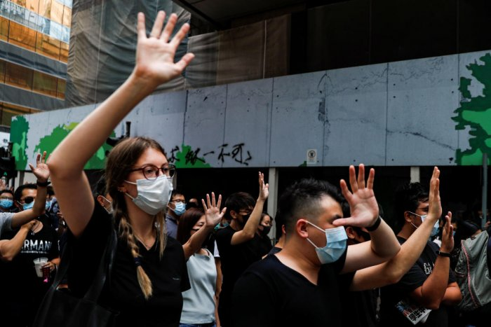 People march to protest against what they say is the abuse of pro-democracy protesters by Hong Kong police, in Central district, Hong Kong, China October 18, 2019. REUTERS/Ammar Awad