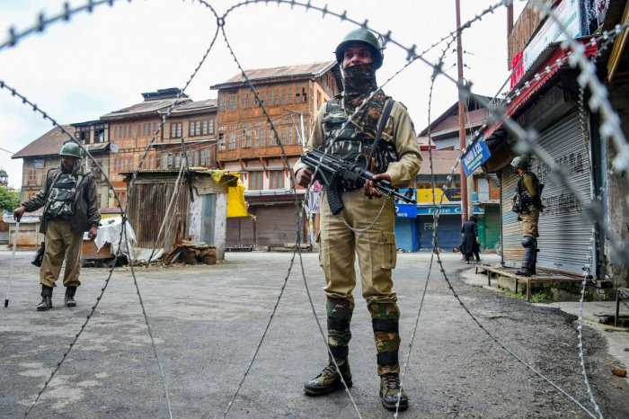 Security personnel stand guard during restrictions, in Srinagar, Friday, Oct. 18, 2019. PTI Photo