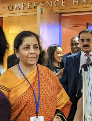 Finance Minister Nirmala Sitharaman interacts with global investors at the headquarters of International Monetary Fund, in Washington. (PTI Photo)
