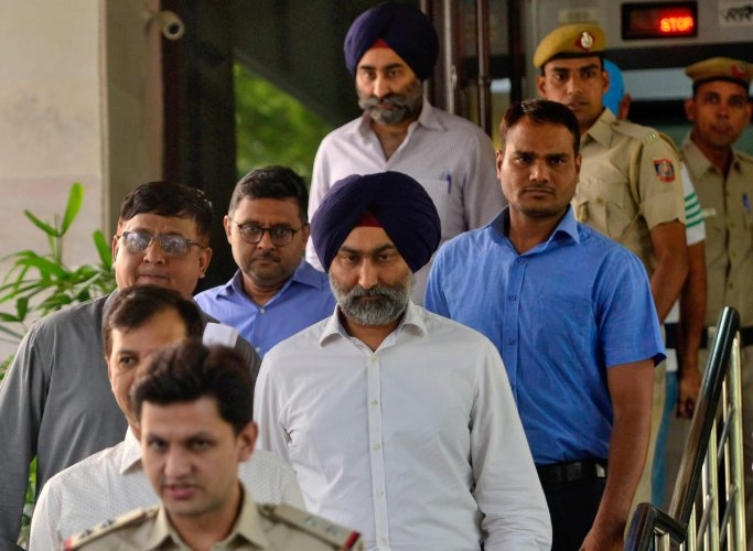 Police escort Malvinder Singh and his brother Shivinder Singh, former directors of Ranbaxy Laboratories, inside a court premises in New Delhi, India, October 11, 2019. REUTERS Photo