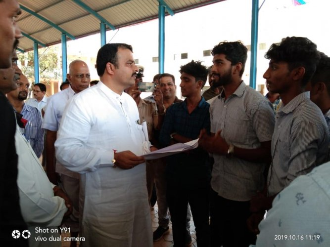 Students of Government First Grade College submit a memorandum to MLA Sunil Kumar in Hebri.