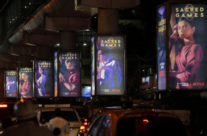 """Traffic moves on a road past hoardings of Netflix's new television series """"Sacred Games"""" in Mumbai. (Photo by Reuters)"""