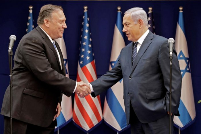 Israeli Prime Minister Benjamin Netanyahu (R) shakes the hand of US Secretary of State Mike Pompeo following their meeting in Jerusalem on October 18, 2019. AFP
