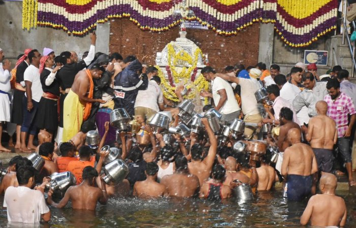 Devotees throng Talacauvery to collect water from Theerthakundike, after the Theerthodbhava celebrations.