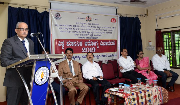 District Principal and Sessions Judge Kadloor Sathyanarayanacharya speaks at World Mental Health Day programme at Government Teacher Education Training Institute in Mangaluru on Friday.