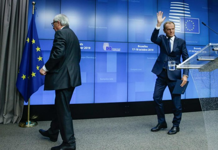 European Council President Donald Tusk (R) and European Commission President Jean-Claude Juncker depart after addressing media representatives at a press conference during a European Union Summit at European Union Headquarters in Brussels on October 18, 2019. AFP