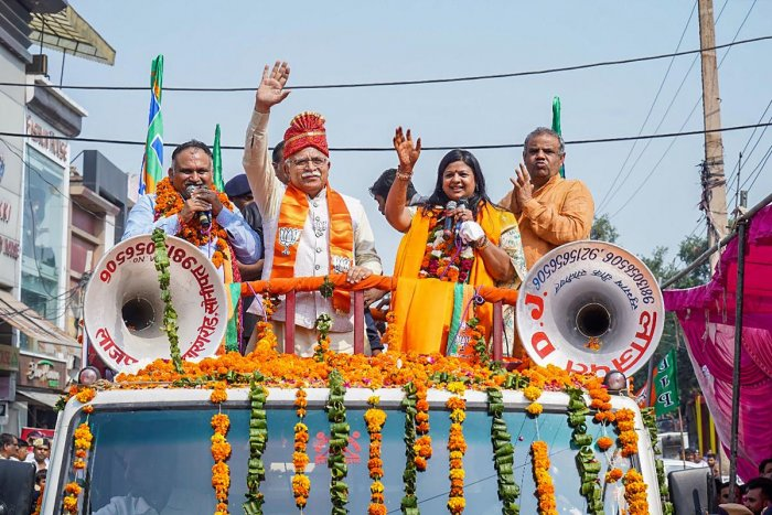 Haryana Chief Minister Manohar Lal Khattar waves at his supporters during a roadshow in support of BJP candidate Kavita Jain, ahead of Haryana Assembly polls, in Sonipat, Saturday, Oct. 19, 2019. (PTI Photo)