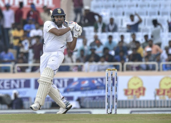 Indian batsman Rohit Sharma plays a shot during 3rd Test match between India and South Africa at JSCA Stadium in Ranchi, Saturday, Oct. 19, 2019. (PTI Photo/Ashok Bhaumik)