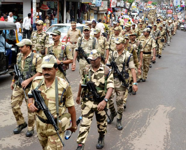 CISF with other security forces personnel conduct a march in city area ahead of Maharashtra Assembly elections, in Karad, Maharashtra, Saturday, Oct. 19, 2019. (PTI Photo)